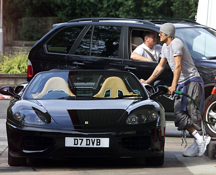 David Beckham spotted filling his Ferrari with petrol in Wilmslow, Cheshire.