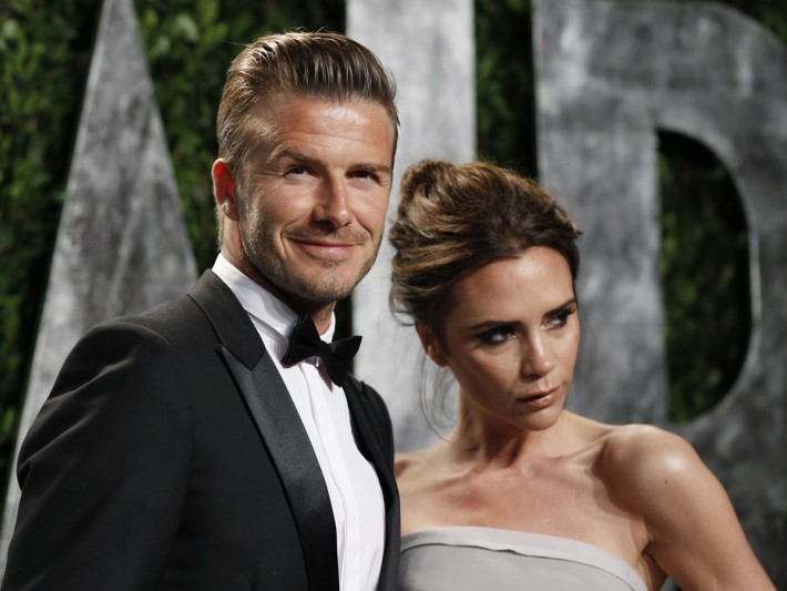 Soccer player David Beckham and his wife Victoria Beckham arrive at the 2012 Vanity Fair Oscar party in West Hollywood, California February 26, 2012. REUTERS/Danny Moloshok (UNITED STATES - Tags: ENTERTAINMENT SPORT SOCCER)  (OSCARS-PARTIES) - RTR2YIRL