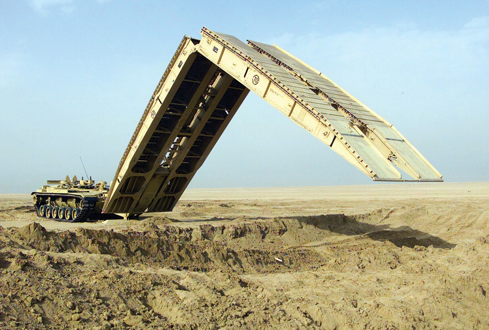 030206-M-5753Q-011 Camp Coyote, Kuwait (Feb. 6, 2003) -- An M60A1 Armored Vehicle Landing Bridge (AVLB) practices the deployment of its 60 foot bridge span, designed to quickly move heavy military wheeled and tracked vehicles over unstable or hazardous terrain.  The equipment is being used in exercises being conducted as part of Operation Enduring Freedom.  U.S. Marine Corps photo by Lance Cpl. Kevin Quihuis Jr.  (RELEASED)